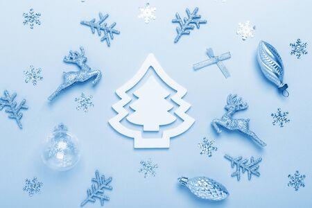 Foto de Christmas composition. Silver decoration on pastel blue background. Christmas, winter, new year concept. Color of the year 2020 classic blue toned - Image - Imagen libre de derechos