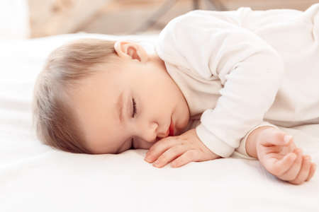 Photo pour Little baby sleeping on bed at home close-up - image libre de droit