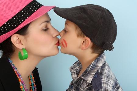 Brunette mother kissing her son on his lips