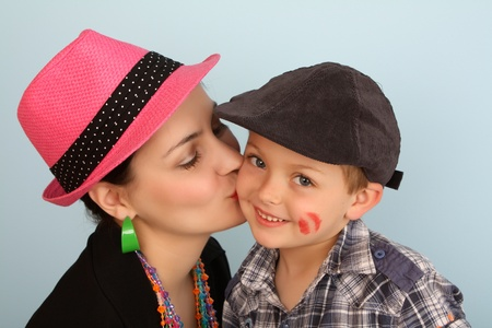 Brunette mother kissing her son on his cheek