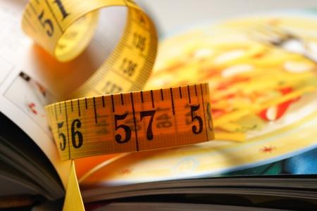 measuring tape on a cookbook