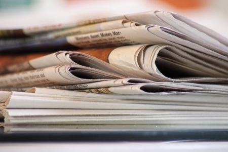 stack of morning newspapers