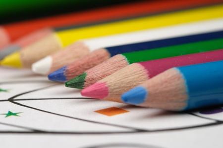 Pretty color pencils and child's coloring book