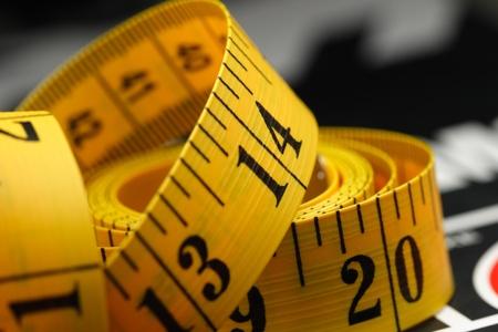 Photo pour yellow tape measure on a book  - image libre de droit