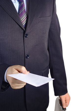 Businessman handing over a blank letter against white background