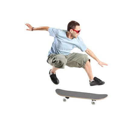 A skateboarder jumping isolated on a white background