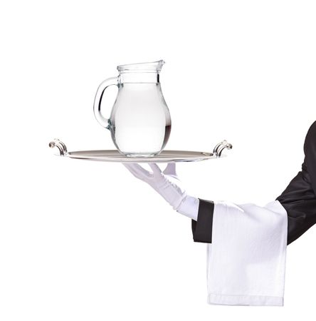 Waiter holding a silver tray with a water pitcher on it