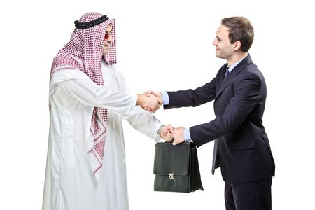 Arab person shaking hands with a businessman isolated on whiteの写真素材