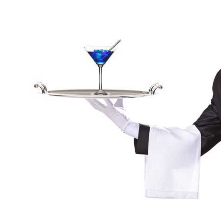 A butler holding a tray with cocktail blue curacao on it isolated on white