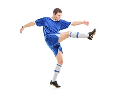 Photo pour A soccer player shooting isolated on white background - image libre de droit