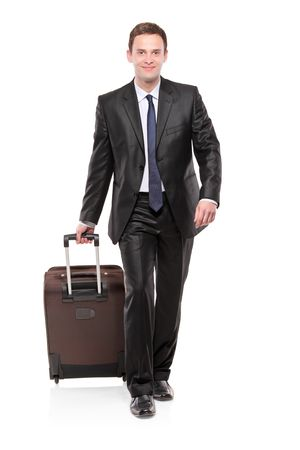 Business traveler carrying a suitcase isolated on white background