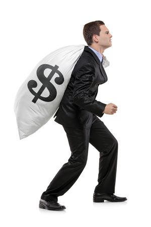 Full length portrait of a businessman carrying a money bag with US dollar sign isolated on white background