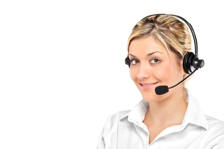 Portrait of a young female customer service operator wearing a headset isolated on white background