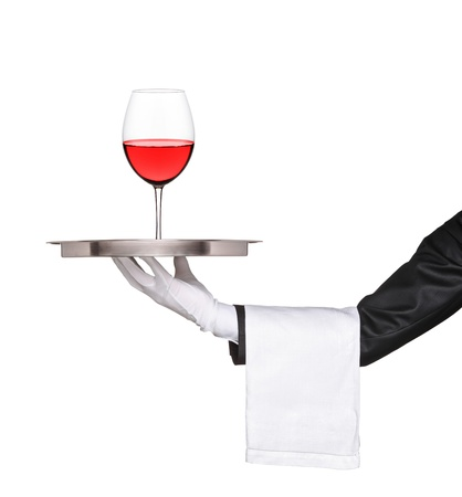 Hand holding a silver tray with a glass of wine on it isolated on white background