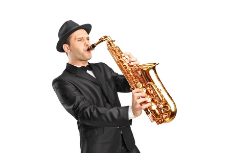 Photo pour Studio portrait of a young man wearing hat and playing on saxophone isolated on background - image libre de droit
