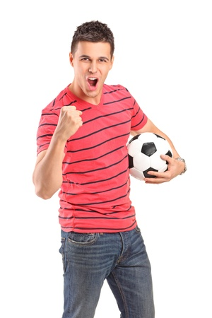 Young man cheering and holding a football on white background