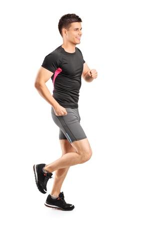 Foto de Man running isolated against white background - Imagen libre de derechos