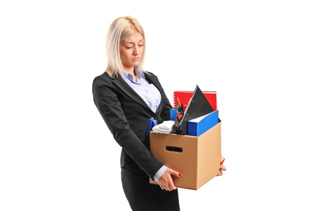 Photo for A fired businesswoman in a suit carrying a box of personal items isolated on white background - Royalty Free Image
