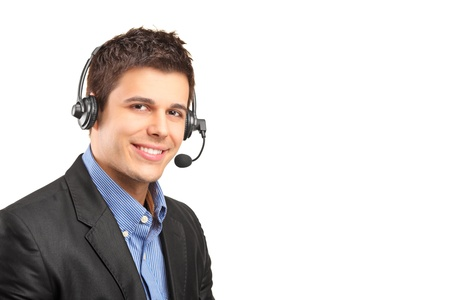 Portrait of a handsome customer service operator wearing a headset isolated on white background