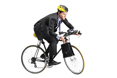 A young businessman riding a bicycle going towards his workplace isolated on white background