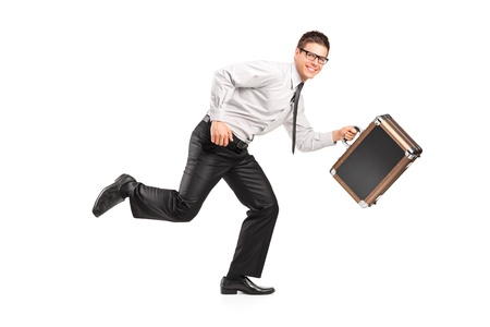 A businessman running with a briefcase isolated against white background