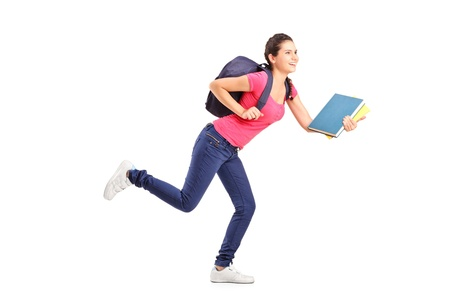 Young female student rushing forwards with book in her hand