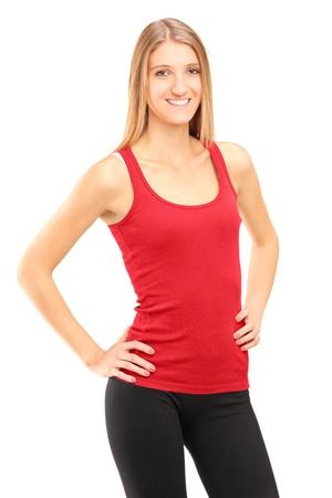 A smiling female athlete posing isolated against white background