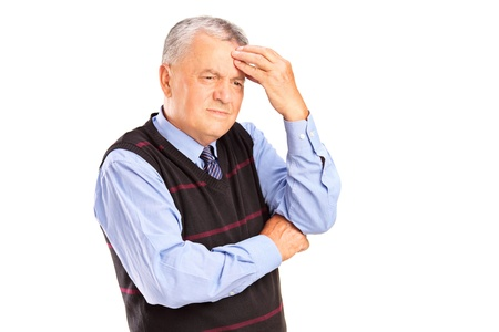 Portrait of a mature man holding his head in pain isolated on white background