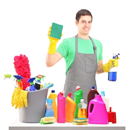 A smiling male cleaner with cleaning equipment isolated on white background