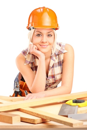 Female carpenter with helmet posing at workplace isolated on white background