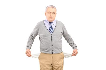 Senior man with empty pockets, isolated on white background