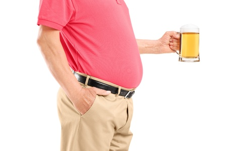 An old man with belly holding a beer glass isolated on white background