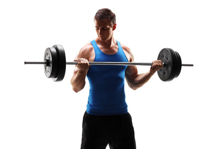 Muscular young man exercising with a barbell isolated on white background