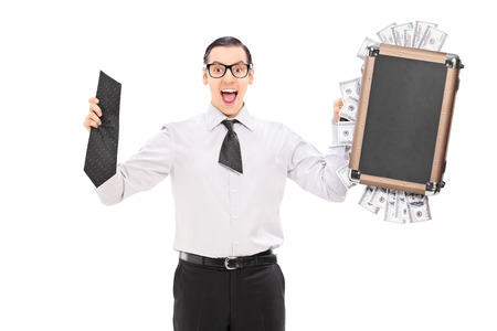 Happy man holding a briefcase full of money and a tie split in half isolated on white background