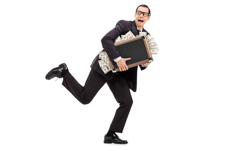 Businessman running with a bag full of money isolated on white background