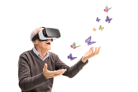 Photo pour Joyful senior gentleman visualizing butterflies via VR headset isolated on white background - image libre de droit