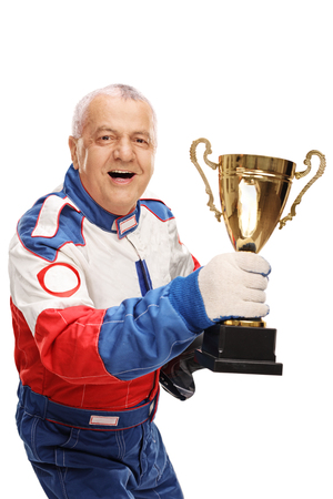 Studio shot of a joyful mature racing champion holding a trophy and celebrating isolated on white background