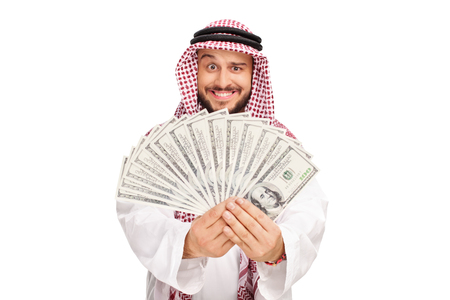 Joyful Arab holding a stack of money isolated on white background