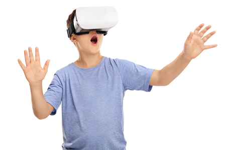Photo pour Amazed little boy looking in a VR goggles and gesturing with his hands isolated on white background - image libre de droit