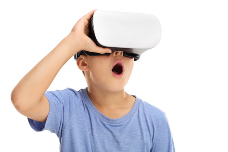 Photo pour Amazed little boy experiencing virtual reality isolated on white background - image libre de droit