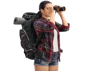 Foto de Female hiker looking through binoculars isolated on white background - Imagen libre de derechos
