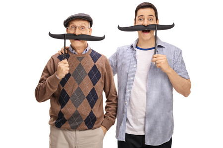 Photo pour Senior and a young man posing with big fake moustaches isolated on white background - image libre de droit
