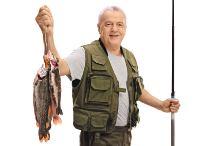 Photo pour Happy mature fisherman with a fresh catch and a fishing rod isolated on white background - image libre de droit