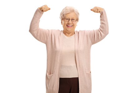 Photo for Cheerful mature woman flexing her muscles isolated on white background - Royalty Free Image