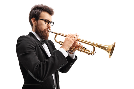 Photo pour Musician playing a trumpet isolated on white background - image libre de droit