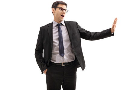 Businessman making a refuse gesture with his hand isolated on white background