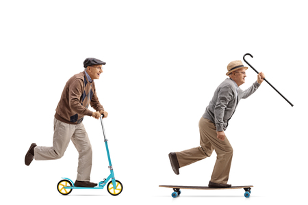 Photo pour Full length profile shot of two elderly men with one of them riding a scooter and the other riding a longboard isolated on white background - image libre de droit