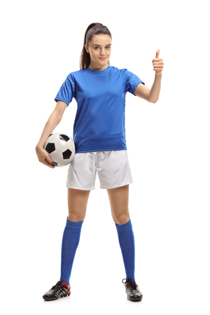 Foto de Full length portrait of a female soccer player making a thumb up sign isolated on white background - Imagen libre de derechos