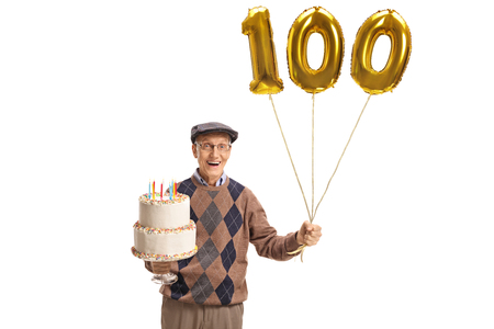 Foto de Happy senior with a birthday cake and a number hundred balloon isolated on white background - Imagen libre de derechos