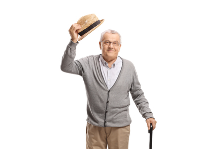 Photo pour Senior man greeting with his hat isolated on white background - image libre de droit